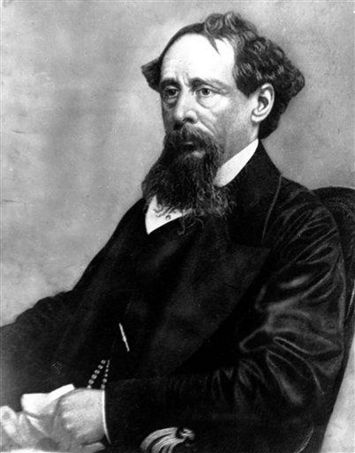 In this undated file photo, novelist Charles Dickens poses for a photograph. Britain's Prince Charles will lay a wreath Tuesday on the writer's grave in Westminster Abbey's Poet's Corner to mark his 200th of birthday. Associated Press