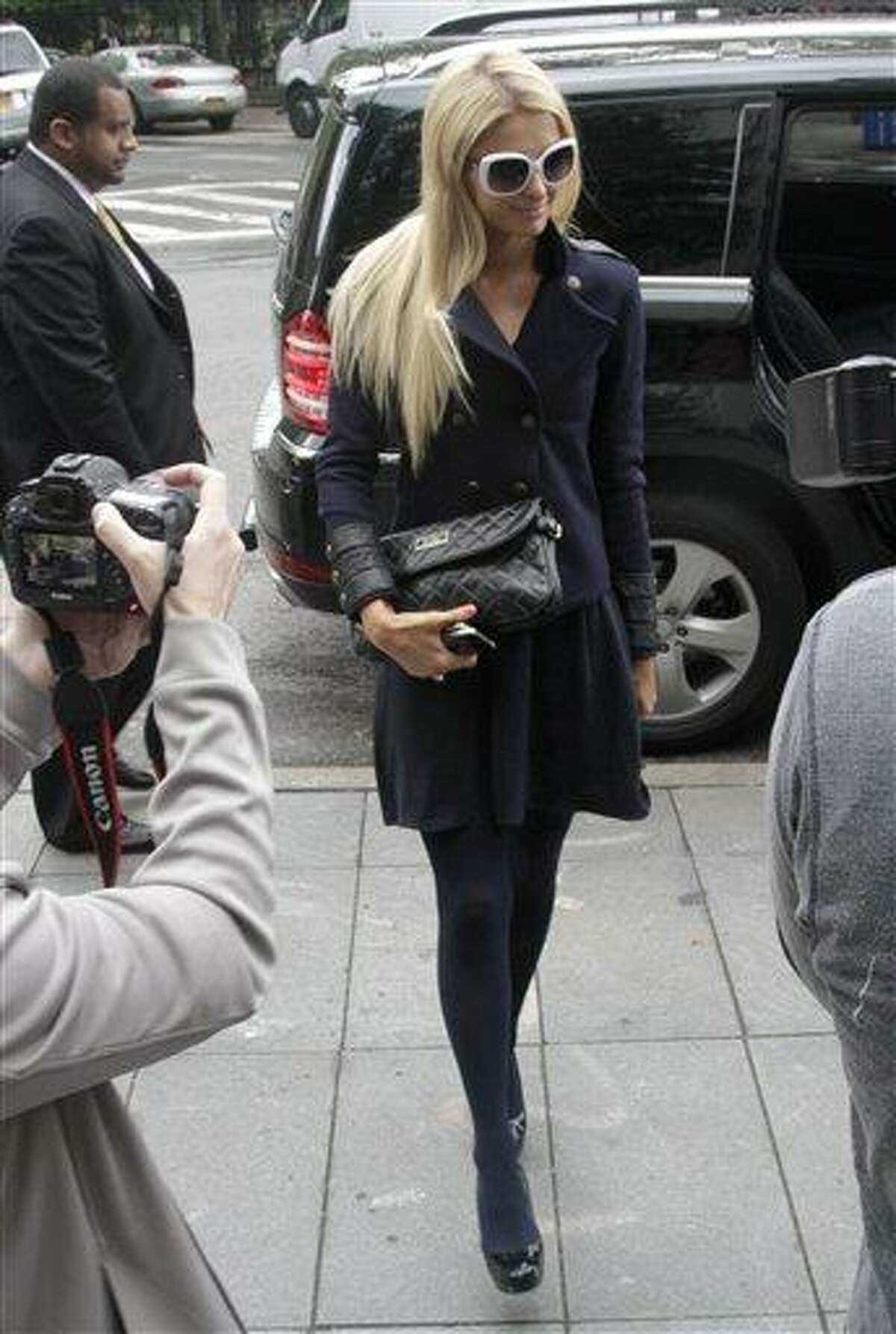 Paris Hilton arrives at federal court in lower Manhattan on Monday, June 4, 2012, in New York. Hilton was in court for settlement talks with an Italian designer that sued her over a licencing agreement to market lingerie under her name. The suit, for unspecified damages, alleges Hilton hurt business by not approving design concepts in a timely manner.