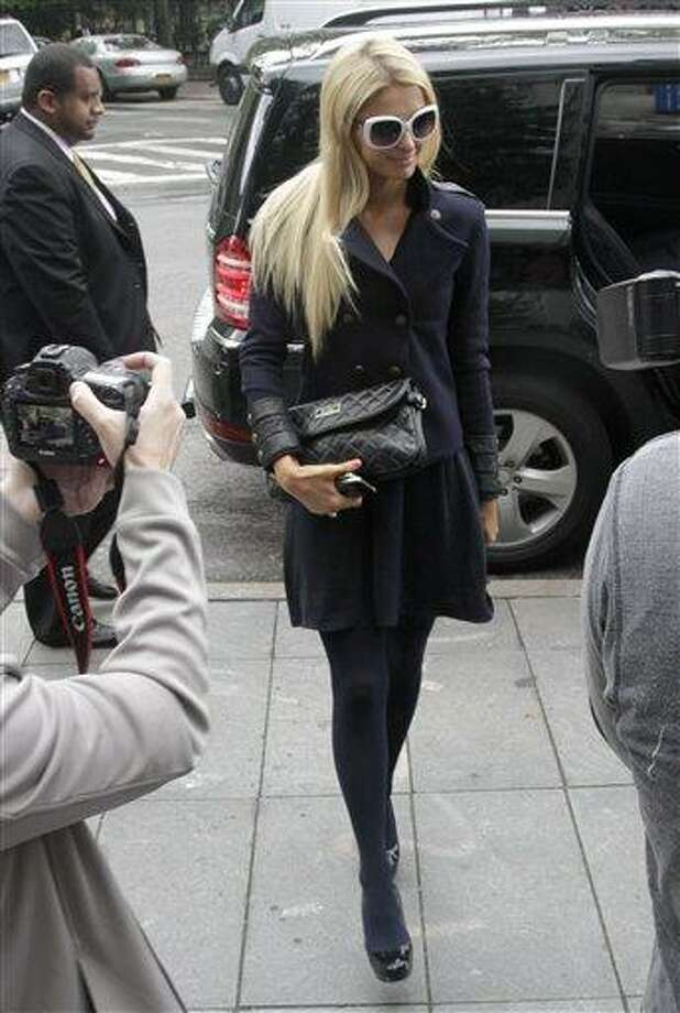 Paris Hilton arrives at federal court in lower Manhattan on Monday, June 4, 2012, in New York. Hilton was in court for settlement talks with an Italian designer that sued her over a licencing agreement to market lingerie under her name. The suit, for unspecified damages, alleges Hilton hurt business by not approving design concepts in a timely manner. Photo: AP / AP