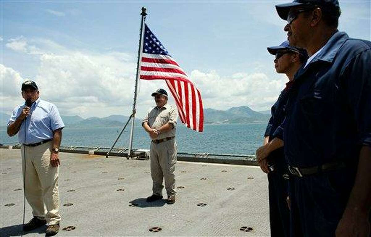 U.S. Secretary of Defense Leon Panetta, left, speaks Sunday to crew members as he visits the USNS Richard E. Byrd in Cam Ranh Bay, Vietnam. Panetta toured the former U.S. air and naval base in the bay, becoming the most senior American official to go there since the war ended. Associated Press