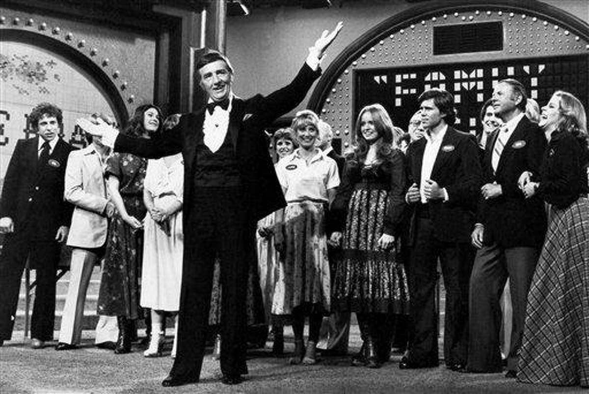 In this May 8, 1978 file photo, Richard Dawson, foreground, in his familiar role as host of