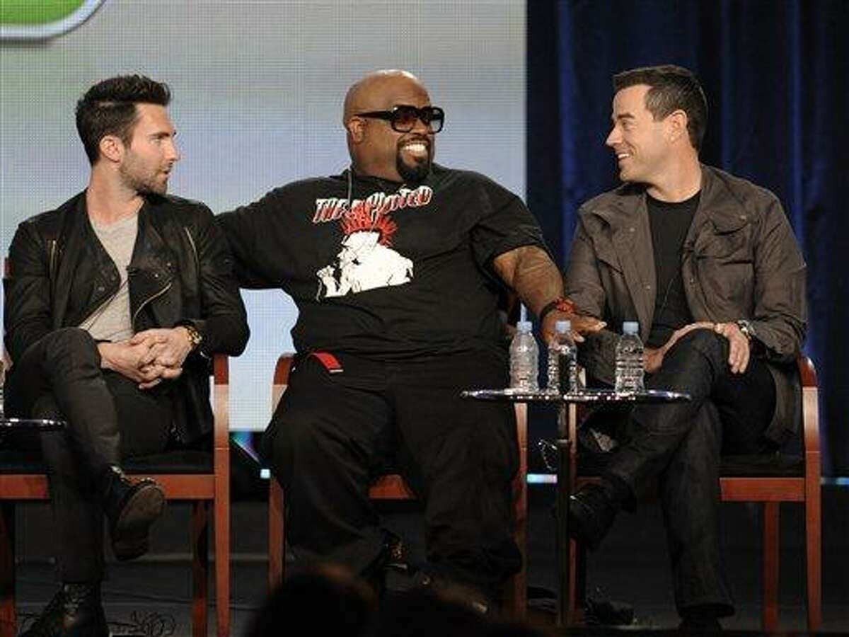 Singer Adam Levine, left, singer Cee Lo Green, center, and television personality Carson Daly speak during the panel discussion for the reality series