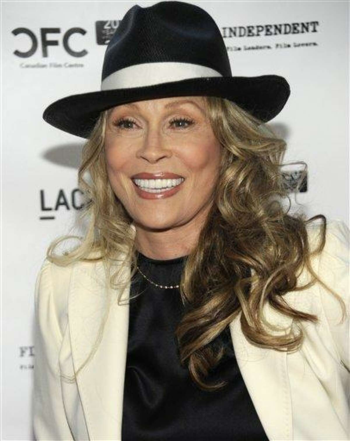 In this April 17, 2009 file photo, actress Faye Dunaway arrives at a tribute event and screening for director Norman Jewison at the Los Angeles County Museum of Art in Los Angeles. Dunaway is moving on from a fight with a landlord over a New York apartment _ by moving out. The New York Times reported Wednesday, Nov. 23, 2011, the