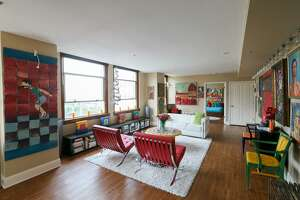 Contemporary art and modern furniture fill the living room of a resident at the Towers of the Majestic.