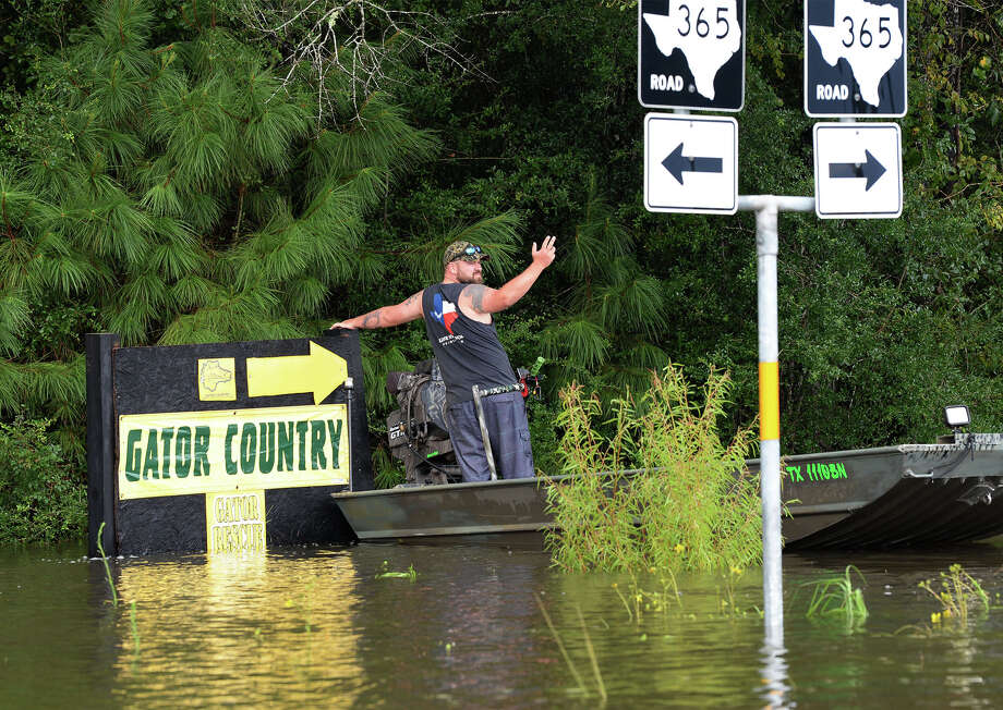A man prepares to dock his boat near the Gator Country sign on Texas 365 Monday. Photo taken Monday, August 28, 2017 Guiseppe Barranco/The Enterprise Photo: Guiseppe Barranco