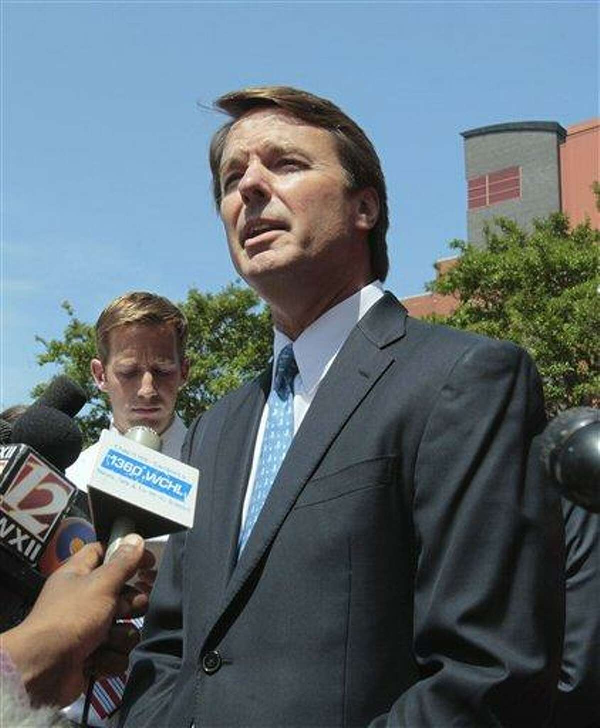 FILE - In this June 3, 2011 file photo, former presidential candidate John Edwards outside federal court appearance in Winston-Salem, N.C. Prosecutors have obtained emails between John Edwards and a former aide to use as evidence at trial that he knew about payments to his pregnant mistress even while he was publicly denying it, people familiar with the case told The Associated Press on Monday. (AP Photo/Gerry Broome, File)