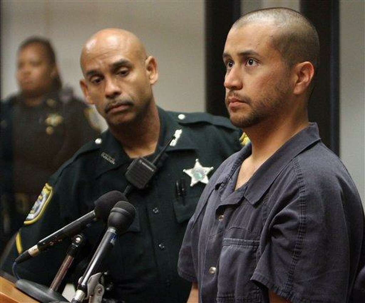 In this April file photo, George Zimmerman, charged with killing 17-year-old Trayvon Martin, right, stands next to a Seminole County Deputy during a court hearing in Sanford, Fla. Associated Press