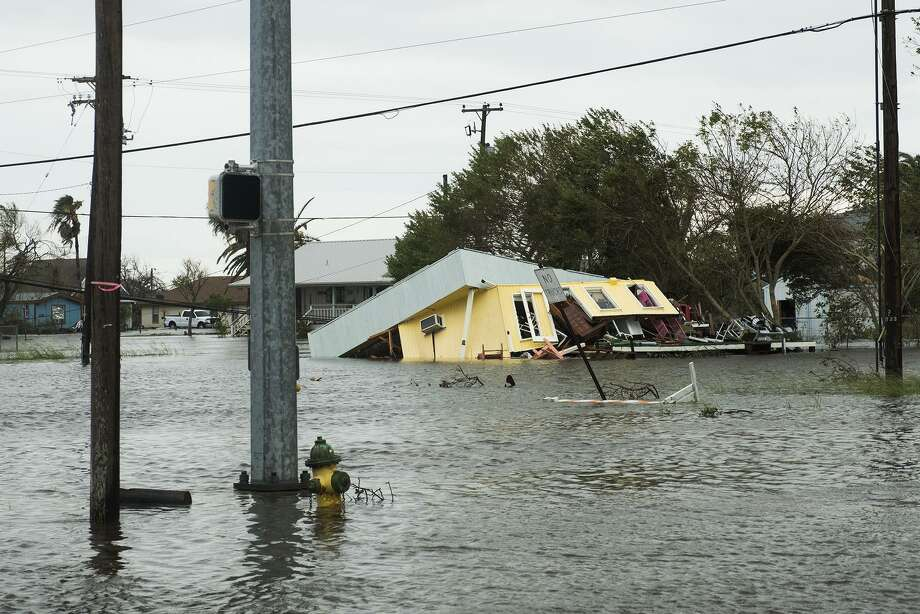 Flooding and a damaged home are seen after Hurricane Harvey hit Rockport, Texas, on Saturday. Photo: Alex Scott /Bloomberg / Bloomberg