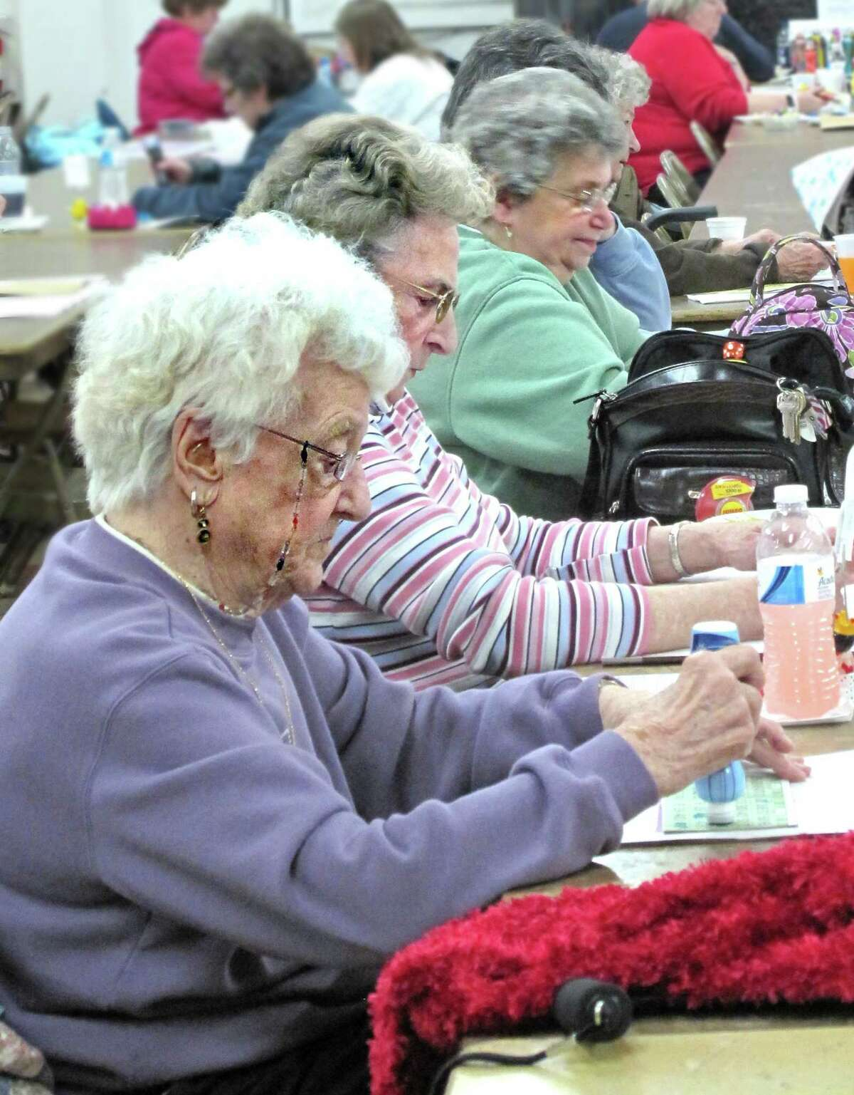 DEBBI MORELLO/Register Citizen Bingo at St. Maron's Church is serious business, even for the early Bingo crowd. Loyal and avid Bingo players concentrate as the numbers are called at St. Maron's Church on Sunday.