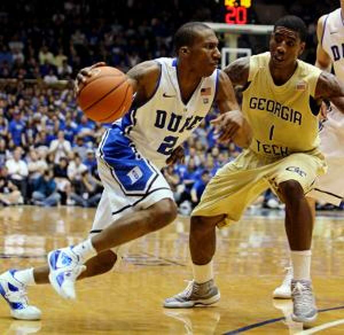 AP Duke's Nolan Smith (2) drives to the basket as Georgia Tech's Iman Shumpert (1) defends during the first half of Sunday's game Durham, N.C. The Blue Devils returned to the No. 1 ranking in the latest AP Top 25 poll.