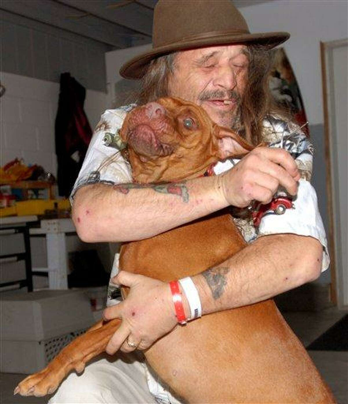 Dan Conne hugs his dog, Jesse, Sunday at the pound in Gold Beach, Ore., where he was with her after they spent six night lost in the woods. Conne, his wife, Belinda, and son, Michael were airlifted out of the Rogue River-Siskiyou National Forest on Saturday and spent the night at the Curry General Hospital recuperating from their ordeal. The dog walked out with a ground search team. Conne said at one point he thought he might have to kill the dog for food, but his wife said they never could have done that. Associated Press