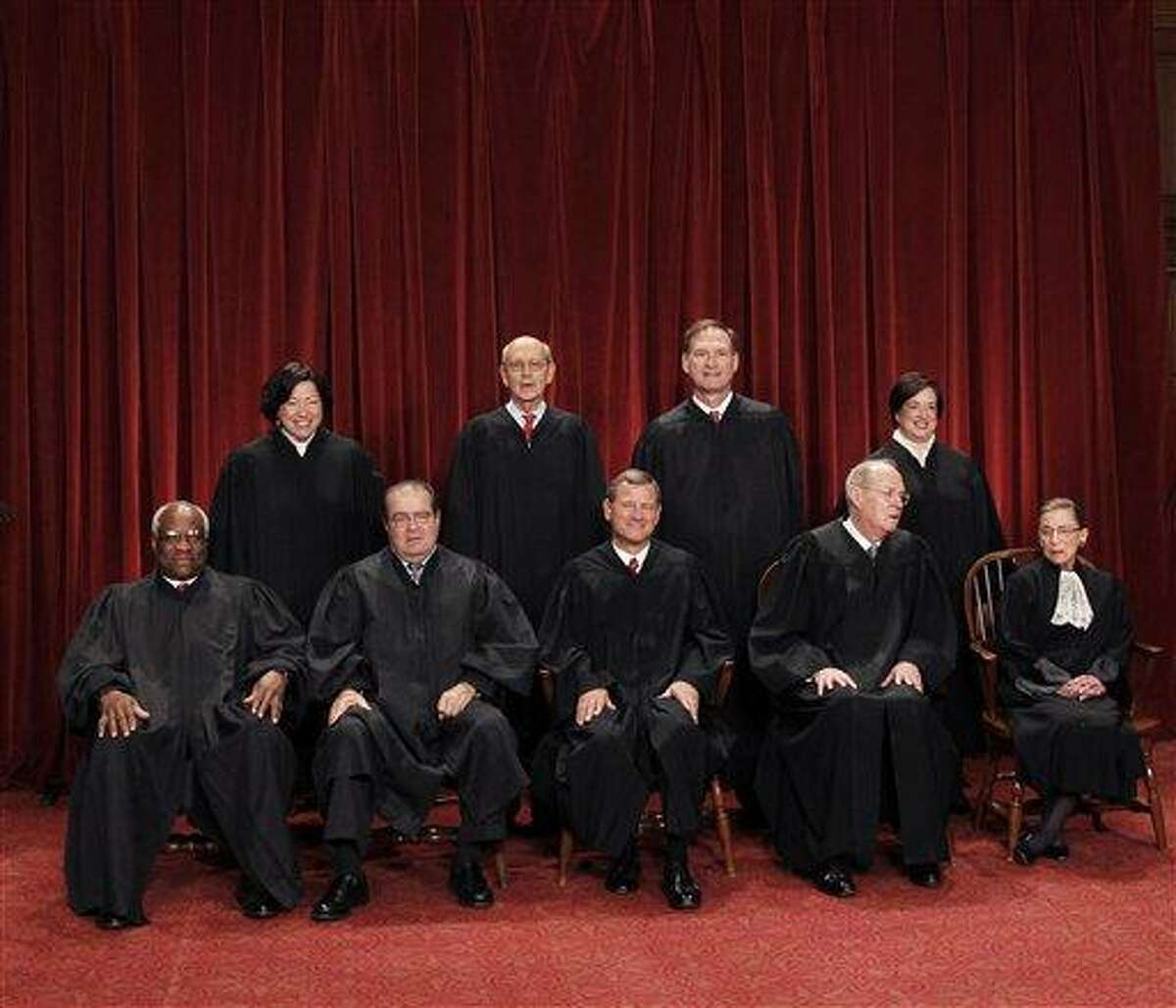 The Supreme Court is embarking on a new term beginning Monday that could be as consequential as the last one with the prospect for major rulings about affirmative action, gay marriage and voting rights. Seated from left to right are: Associate Justice Clarence Thomas, Associate Justice Antonin Scalia, Chief Justice John G. Roberts, Associate Justice Anthony M. Kennedy, Associate Justice Ruth Bader Ginsburg. Standing, from left are: Associate Justice Sonia Sotomayor, Associate Justice Stephen Breyer, Associate Justice Samuel Alito Jr., and Associate Justice Elena Kagan. Associated Press file photo