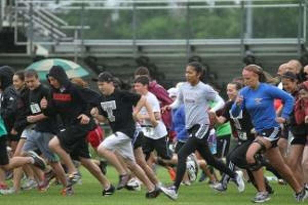 MARIANNE KILLACKEY/Register Citizen Correspondent The first Raider Run 5K race got off to a wet start Saturday morning at Torrington High School. The race, sponsored by the Torrington Varsity Alumni Club, was deemed