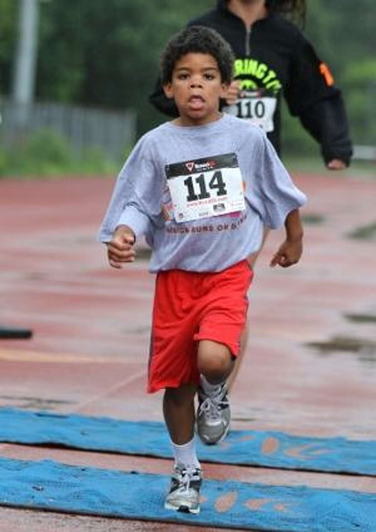 MARIANNE KILLACKEY/Register Citizen Correspondent Runners young and old participated in the first-ever Raider Run 5K.