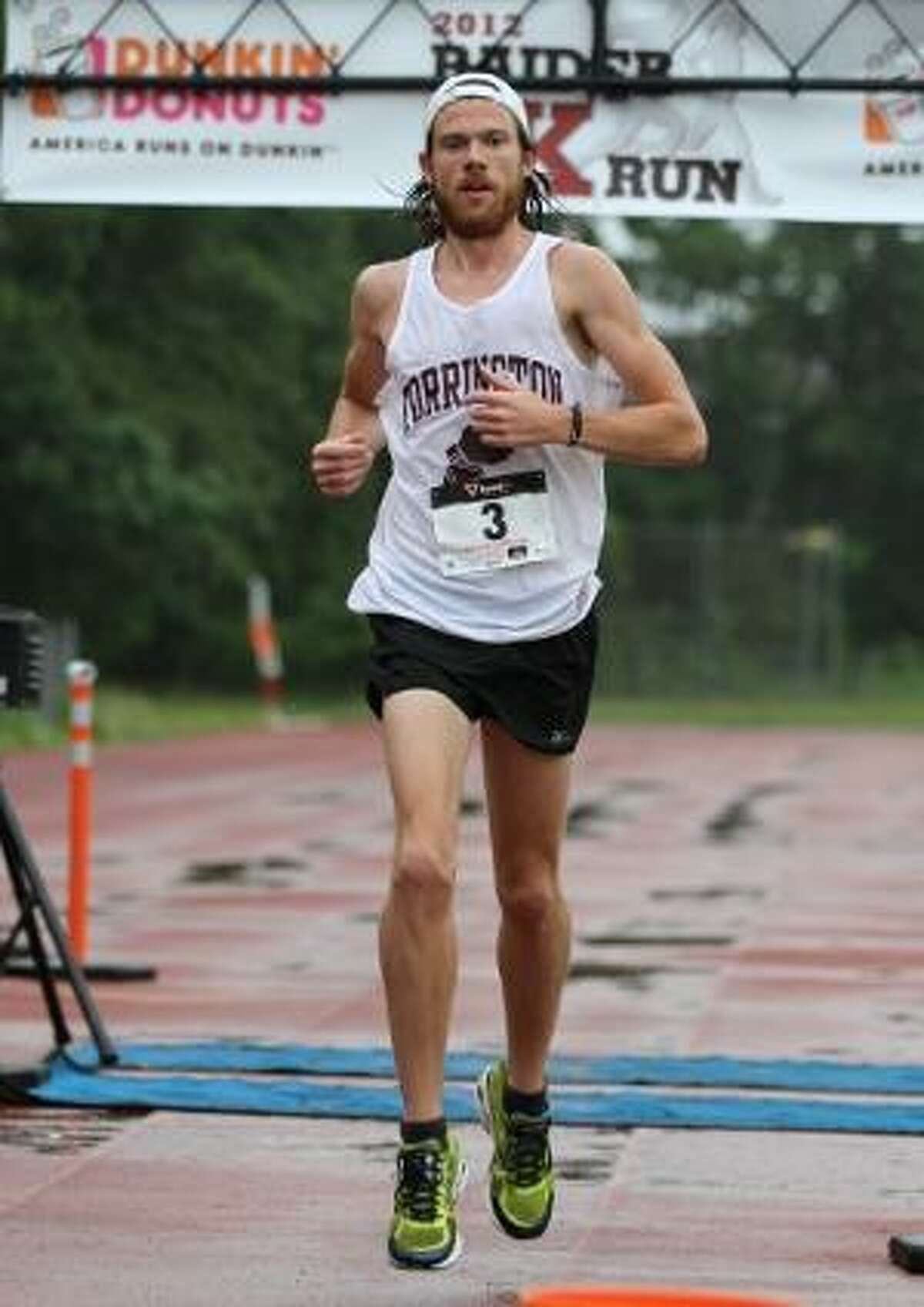 MARIANNE KILLACKEY/Register Citizen Correspondent Torrington High School Class of 2002 graduate and former Red Raider standout Stephen Pretak grabbed the top spot in the first-ever Raider Run 5K on Saturday morning.