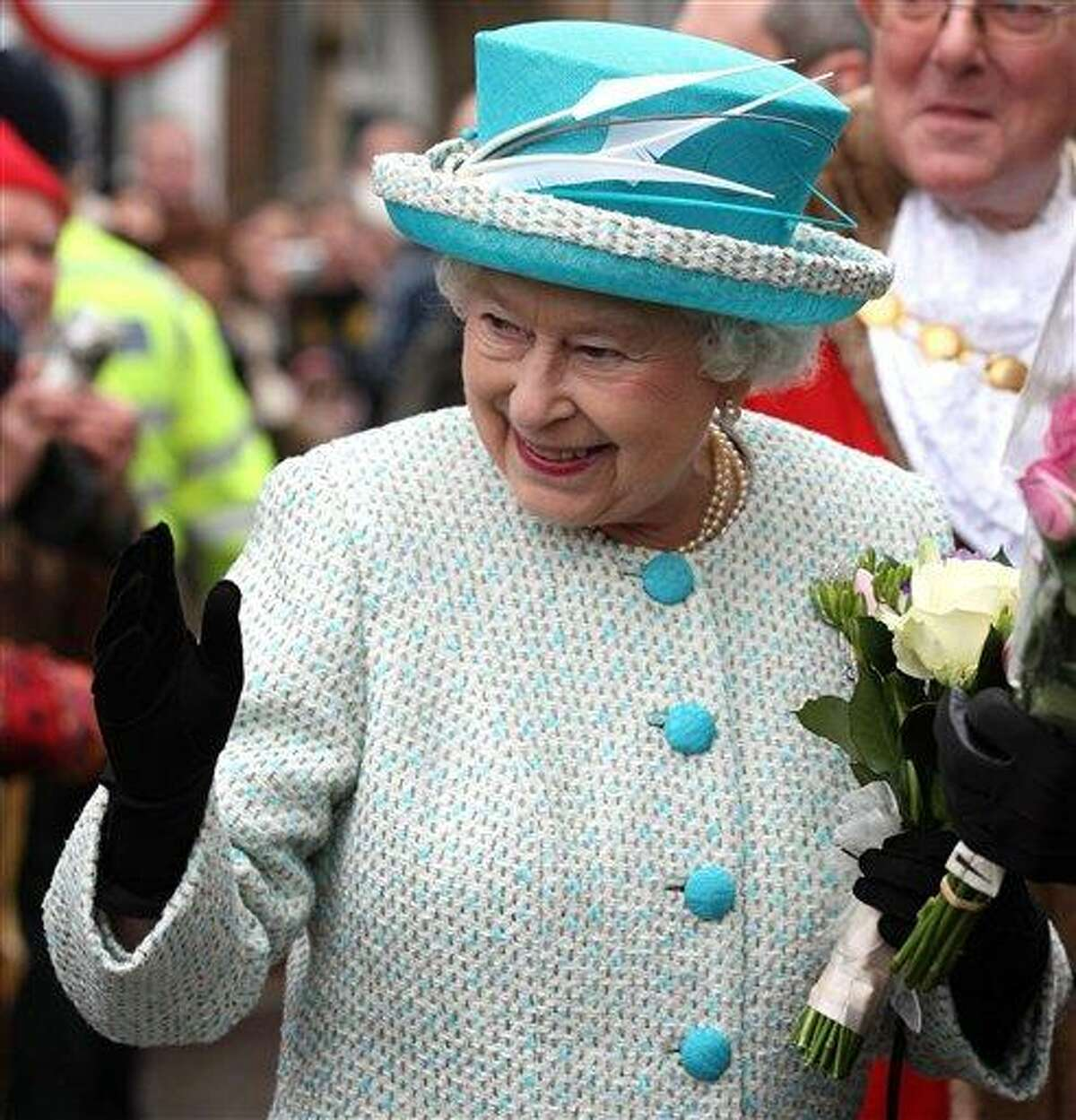 Britain's Queen Elizabeth II, waves to well-wishers during a visit to Kings Lynn Town Hall in eastern England Monday. Associated Press