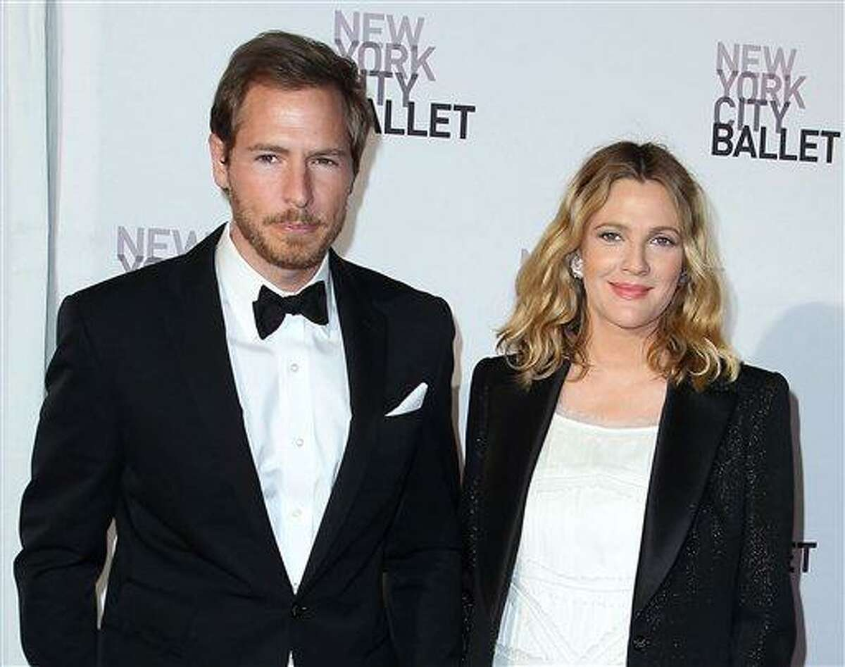 FILE - This May 10, 2012 file photo shows Will Kopelman, left, and Drew Barrymore attending the New York City Ballet's 2012 Spring Gala performance in New York. The couple welcomed a baby girl named Olive Barrymore Kopelman on Sept. 26. A statement from Chris Miller at Barrymore's production company Flower Films said the baby was born