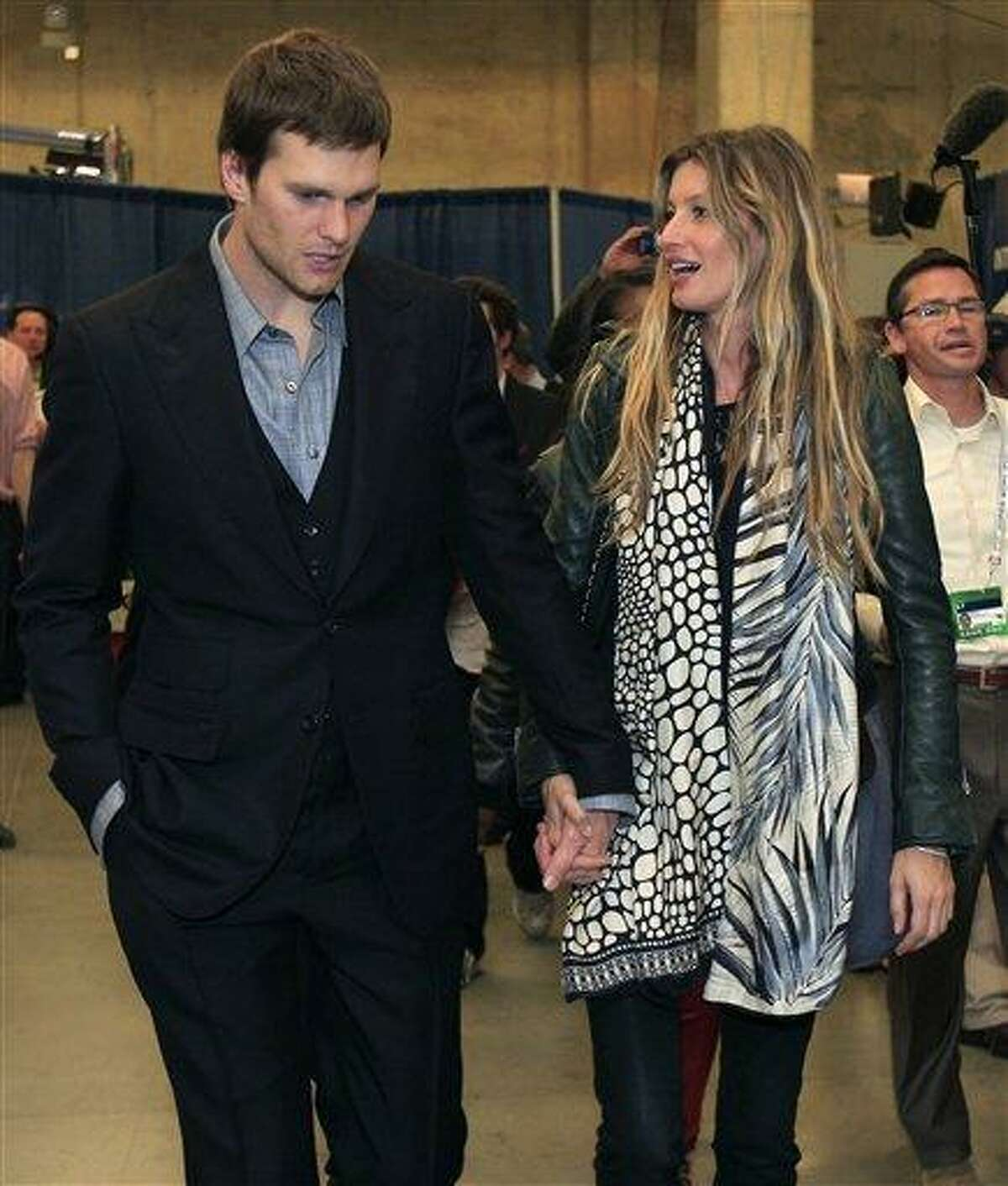 New England Patriots quarterback Tom Brady and his wife, supermodel Gisele Bundchen, leave the stadium after the Patriots lost 21-17 to the New York Giants in the NFL Super Bowl XLVI football game Sunday in Indianapolis. Associated Press