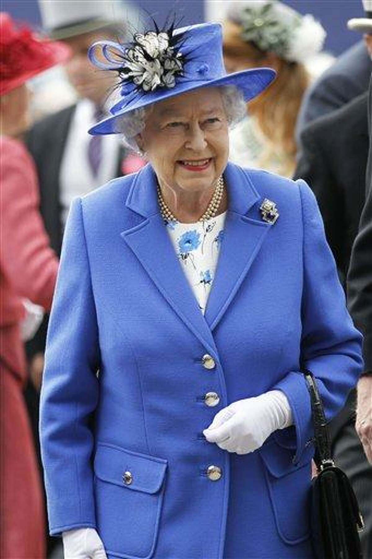 Britain's Queen Elizabeth II arrives for the Epsom Derby at Epsom race course, southern England at the start of a four-day Diamond Jubilee celebration to mark the 60th anniversary of the Queen's accession to the throne Saturday, June 2, 2012. The queen will celebrate Saturday at the Epsom Derby, a highlight of the horseracing calendar, and on Sunday she will lead a 1,000-boat flotilla on the River Thames. Monday's festivities include a pop concert in front of Buckingham Palace with Paul McCartney and Elton John, and festivities climax Tuesday with a religious service, a procession through the streets of London and the royal family's appearance on the palace balcony. (AP Photo/Sang Tan)