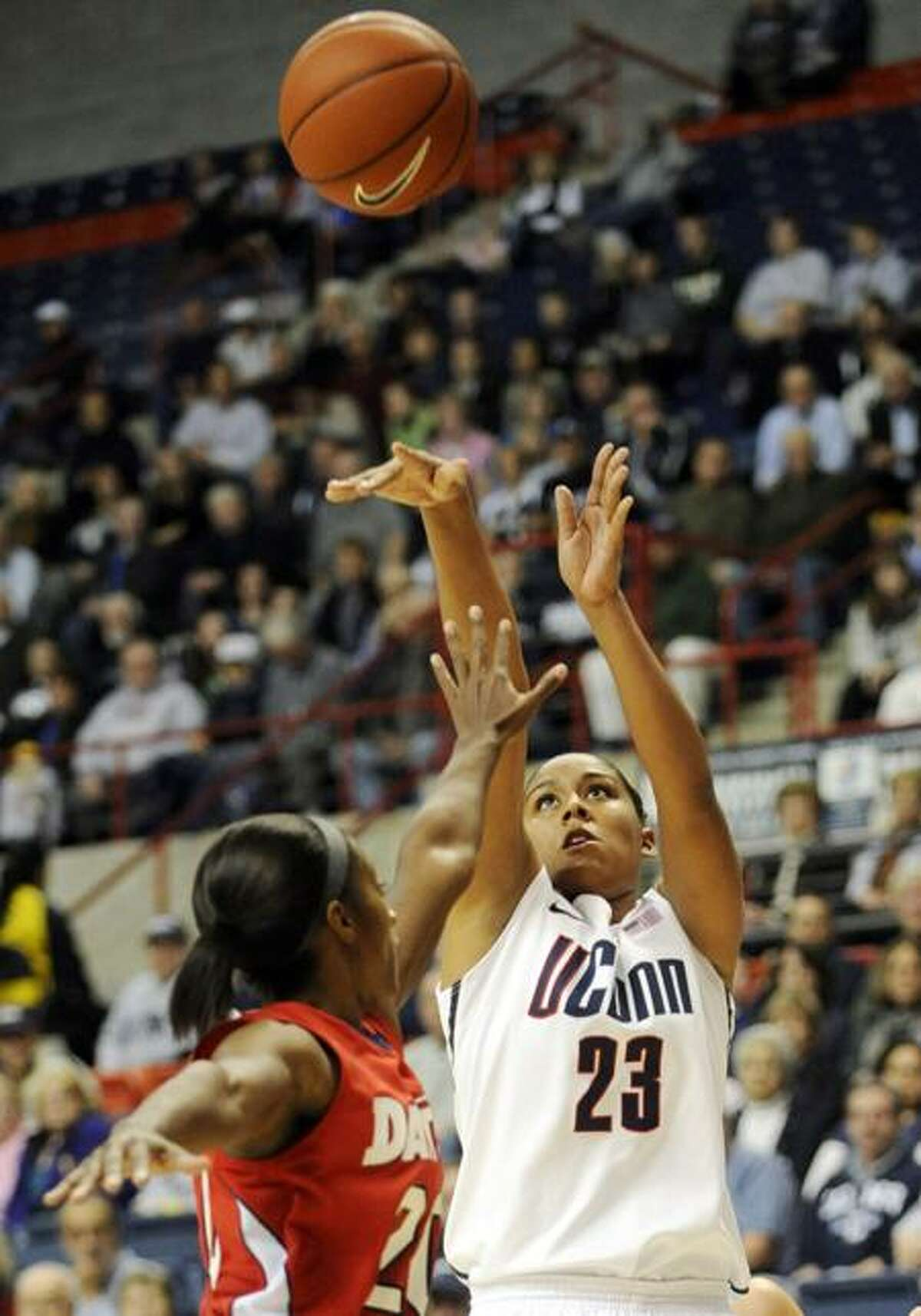 Connecticut's Kaleena Mosqueda-Lewis (23) shoots over Dayton's Patrice Lalor in the first half of an NCAA college basketball game in Storrs, Conn., Sunday, Nov. 27, 2011. Mosqueda-Lewis led No. 2 Connecticut with 23 points in a 78-38 victory. It was the team's 89th straight win at home to set an NCAA record. (AP Photo/Jessica Hill)