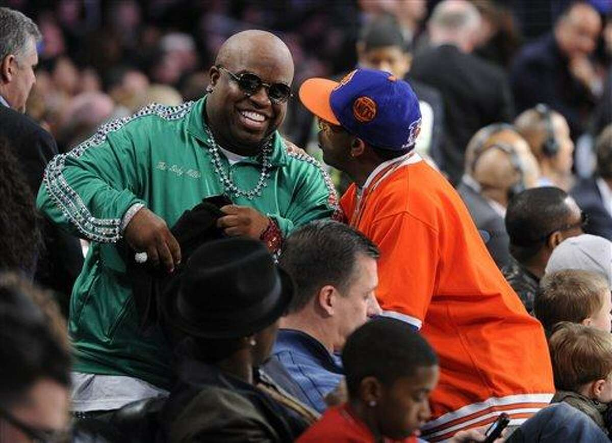 Cee Lo Green, left, has a talk with Spike Lee at the NBA basketball All-Star weekend, on Saturday, Feb. 19, 2011, in Los Angeles.