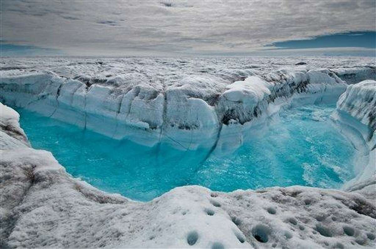 EMBARGOED UNTIL 2 P.M., EST, THURSDAY, NOV. 29 - This handout image provided by Ian Joughin, shows surface melt water rushing along the surface of the Greeland Ice Sheet through a supra-glacial stream channel on July 4, 2012, southwest of Ilulissat, Greenland. Polar ice sheets are now melting three times faster than in the 1990s, but so far that's added just less than half an inch to already rising global sea levels, a new giant scientific study says. While the amount of sea level rise isn't as bad as some earlier worst case scenarios, the acceleration of the melting, especially in Greenland, has ice scientists worried. (AP Photo/Ian Joughin)