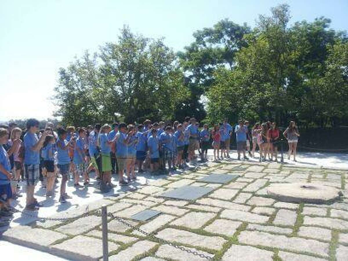 Photo by Jason LaFreniere Torrington Middle School students at the Eternal Flame monument in Washington, DC.