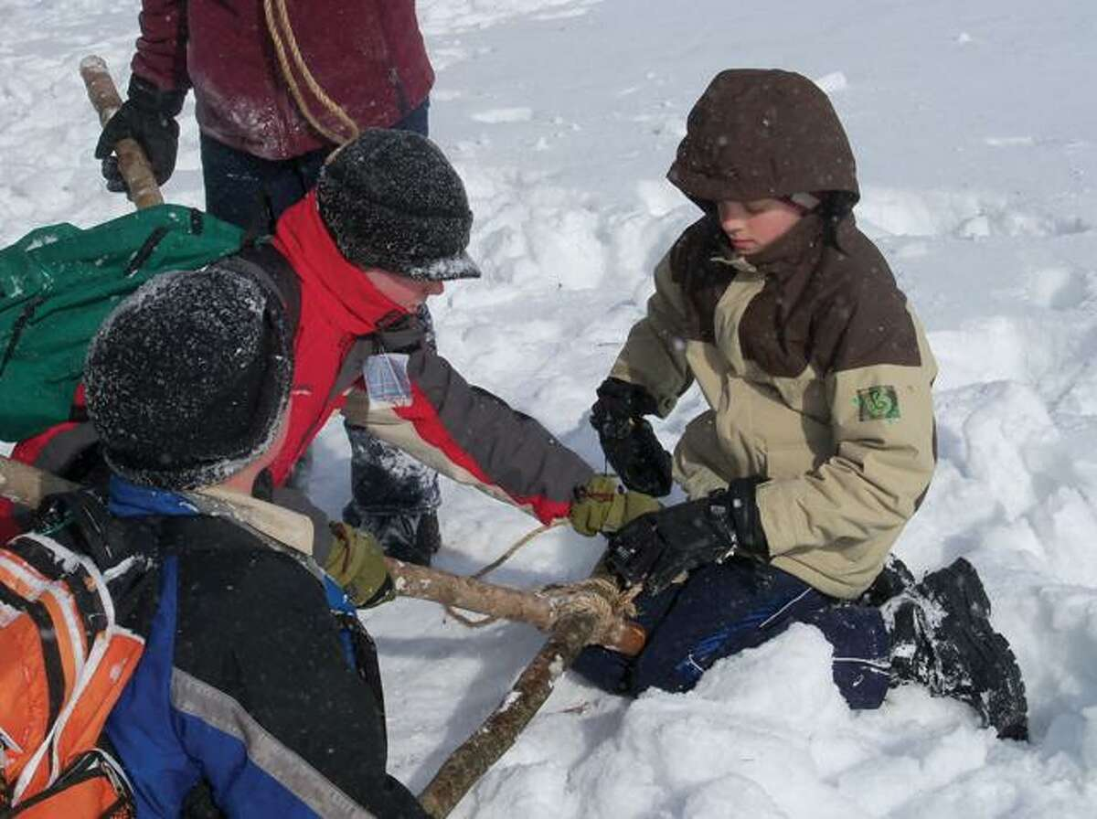 RICKY CAMPBELL/ Register CitizenBoy Scouts assembled a travois amid all the snow and wind Saturday morning as part of their Klondike Derby at White Memorial Foundation. Scouts from all over the region were in attendance working on their outdoorsmanship.