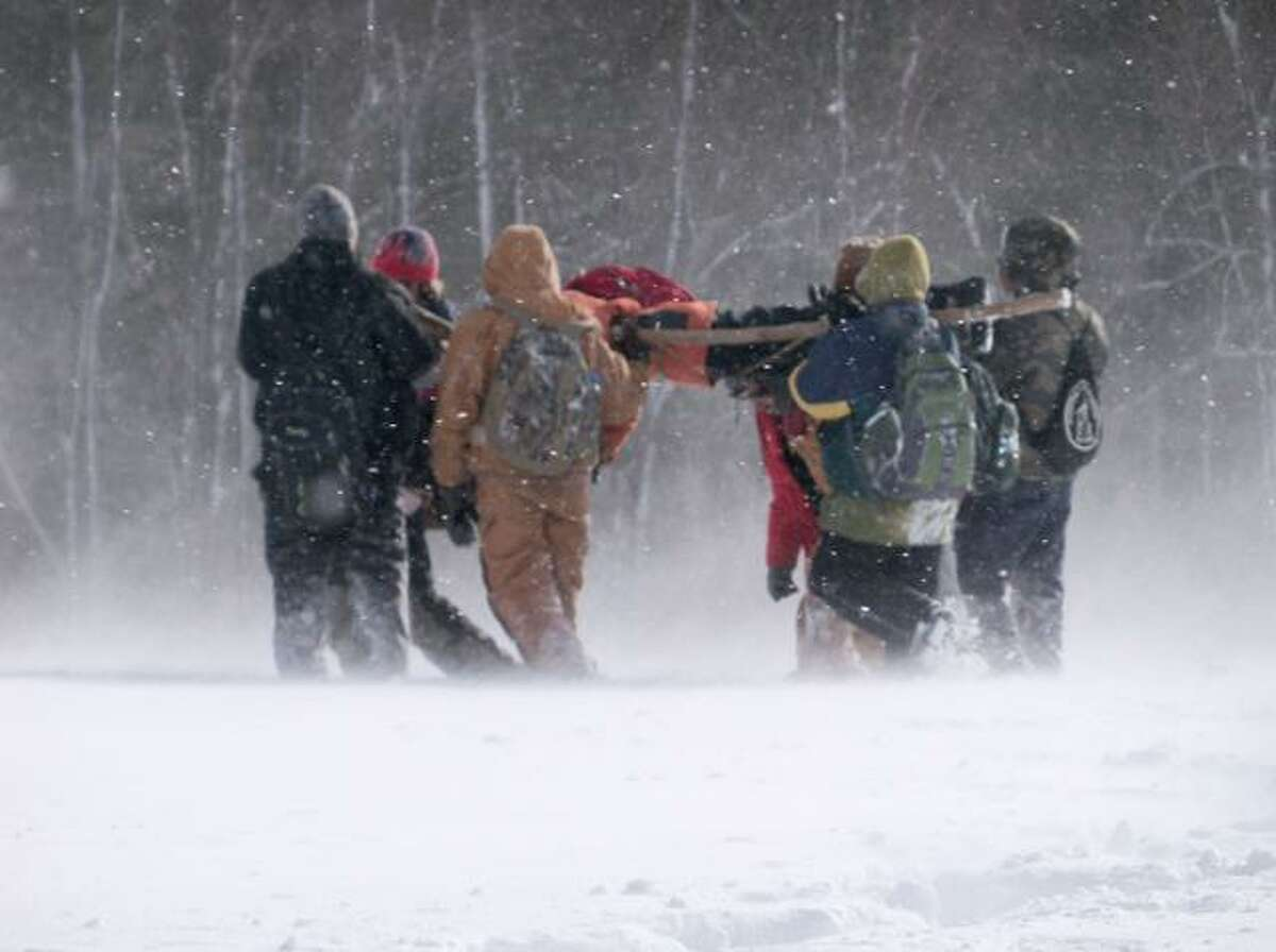 RICKY CAMPBELL/ Register CitizenThe high winds and snow flurries were not able to stop the Boy Scouts from competing in the annual Klondike Derby Saturday. Approximately 300 scouts attended the event to work on their outdoor skills.