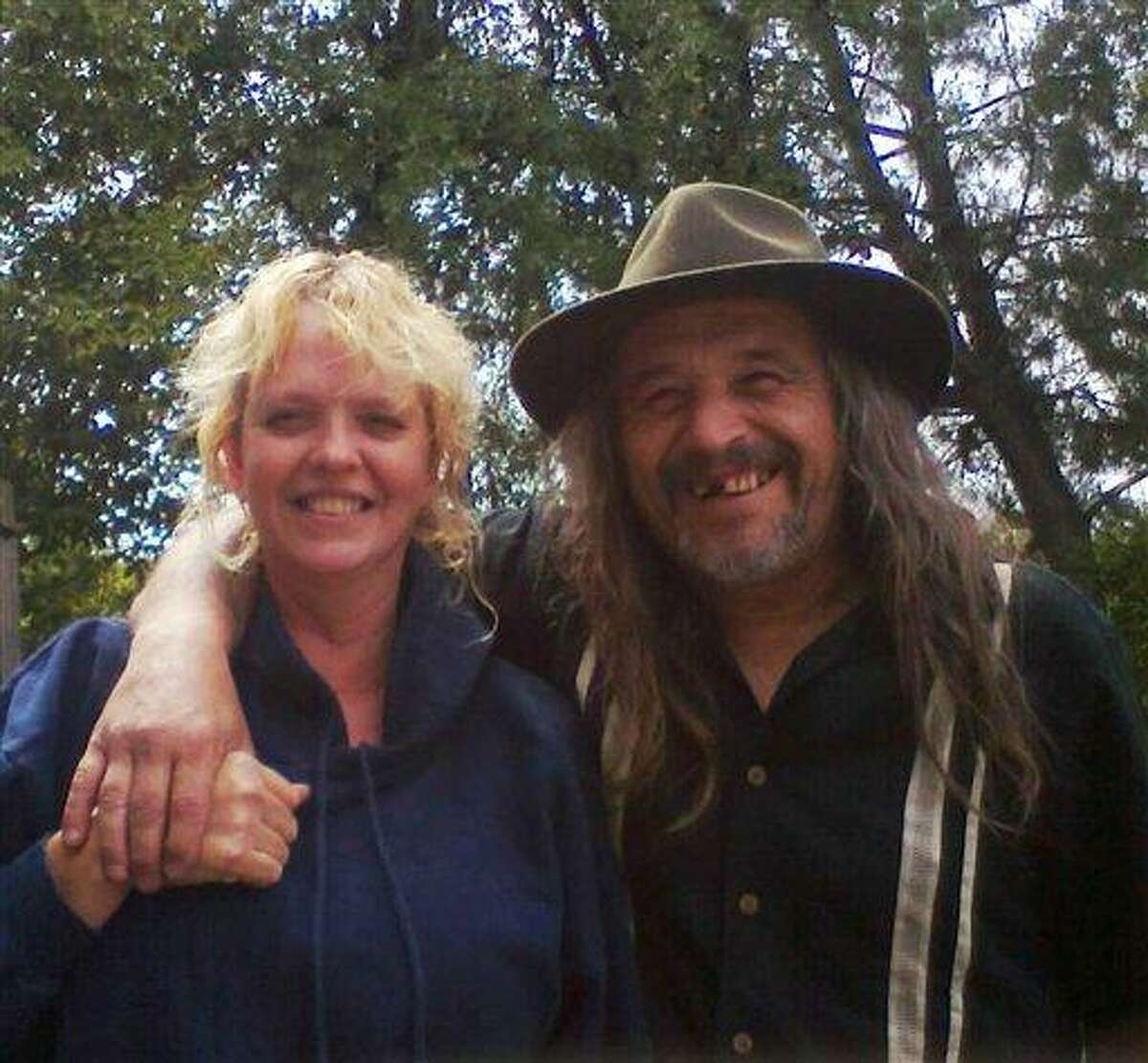This undated photo provided by Karanda Williams shows Daniel and Belinda Conne. The couple and their adult son were found injured but alive Saturday after they got lost while picking mushrooms and survived six days deep in the Oregon coastal forest, taking shelter part of the time in a hollowed-out tree. Belinda and Daniel Conne, both 47, and their 25-year-old son, Michael, were spotted by a helicopter pilot and later flown to a hospital. Curry County Sheriff John Bishop said Daniel Conne suffered a back injury, Belinda Conne had hypothermia, and their son Michael had a sprained foot. All three also were dehydrated and hungry. Associated Press