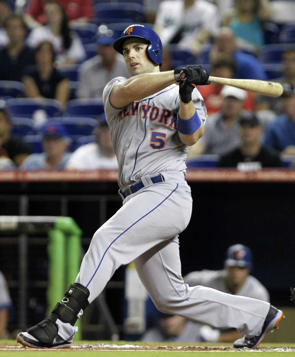 FILE - In this Oct. 2, 2012 file photo, New York Mets' David Wright follows through against the Miami Marlins during a baseball game in Miami. WFAN radio is reporting Friday, Nov. 30, 2012, that Wright and the New York Mets have agreed to a $138 million, eight-year contract that would be the richest in franchise history. (AP Photo/Alan Diaz, File)