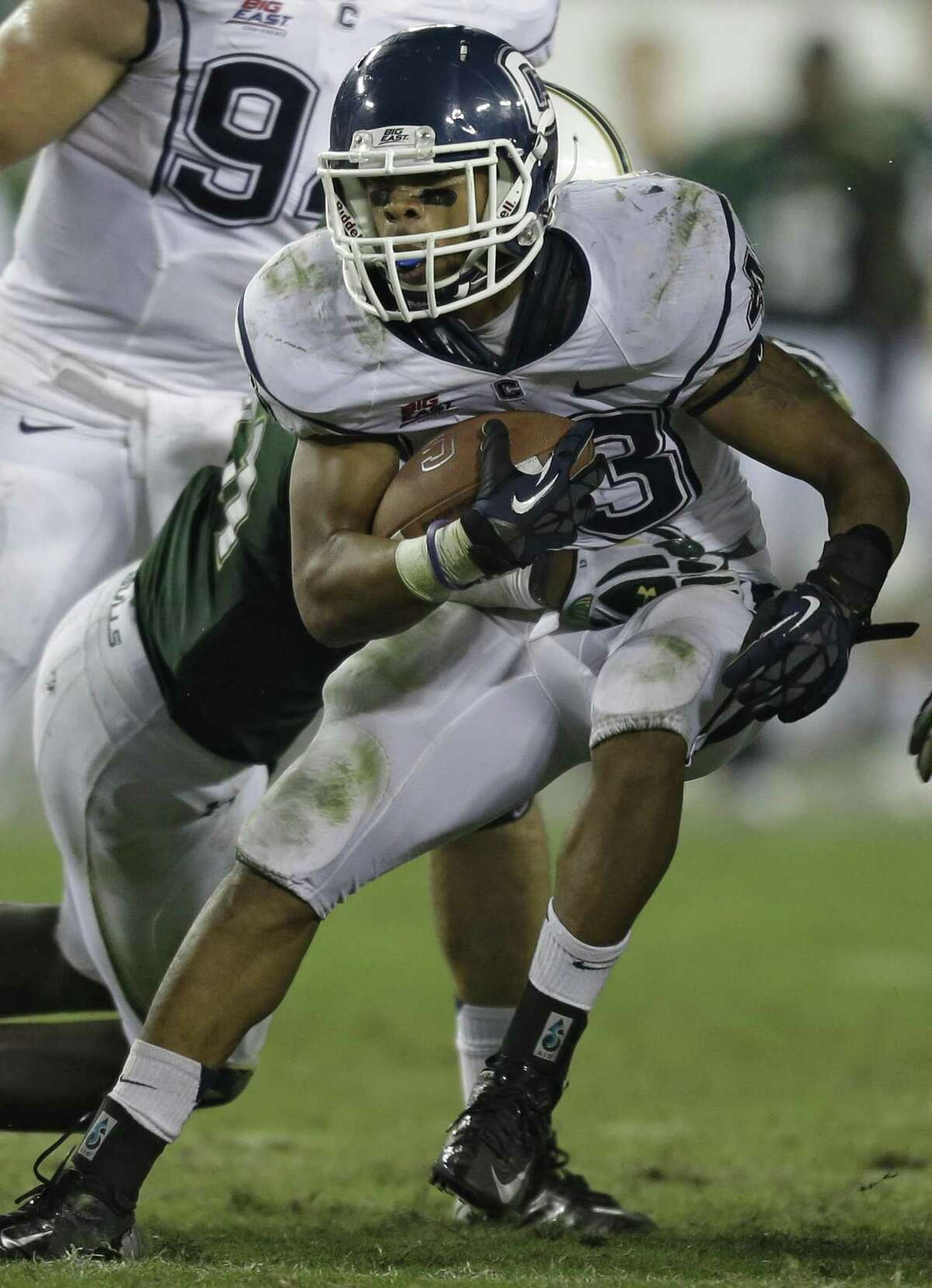 Connecticut running back Lyle McCombs (43) runs with the ball during the fourth quarter of an NCAA college football game against South Florida Saturday, Nov. 3, 2012, in Tampa, Fla. (AP Photo/Chris O'Meara)