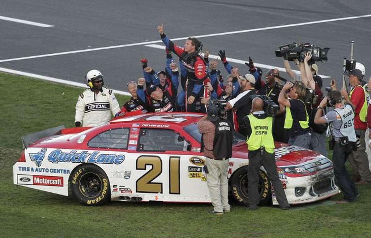 Trevor Bayne, top, celebrates after winning the Daytona 500 NASCAR auto race at Daytona International Speedway in Daytona Beach, Fla., Sunday, Feb. 20, 2011. (AP Photo/David Graham)