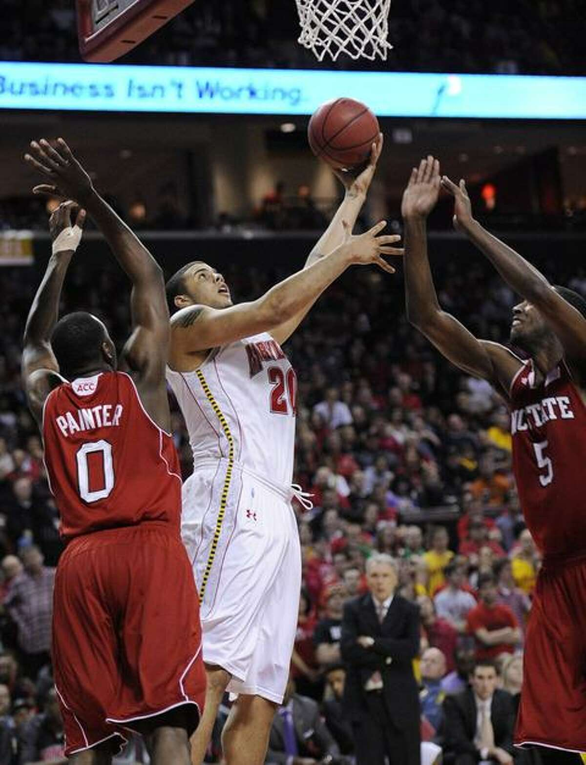 Maryland forward Jordan Williams, center, goes to the basket against North Carolina State's DeShawn Painter (0) and C.J. Leslie (5) during the second half of an NCAA college basketball game, Sunday, Feb. 20, 2011, in College Park, Md. Maryland won 87-80. (AP Photo/Nick Wass)
