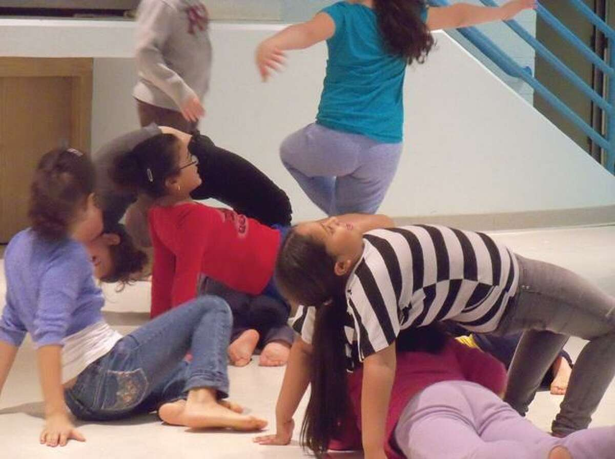 RICKY CAMPBELL/ Register CitizenKids in the After School Arts Program follow each others moves in their interpretive dance warm ups Friday at Forbes School. They have performances on Feb. 24-25.