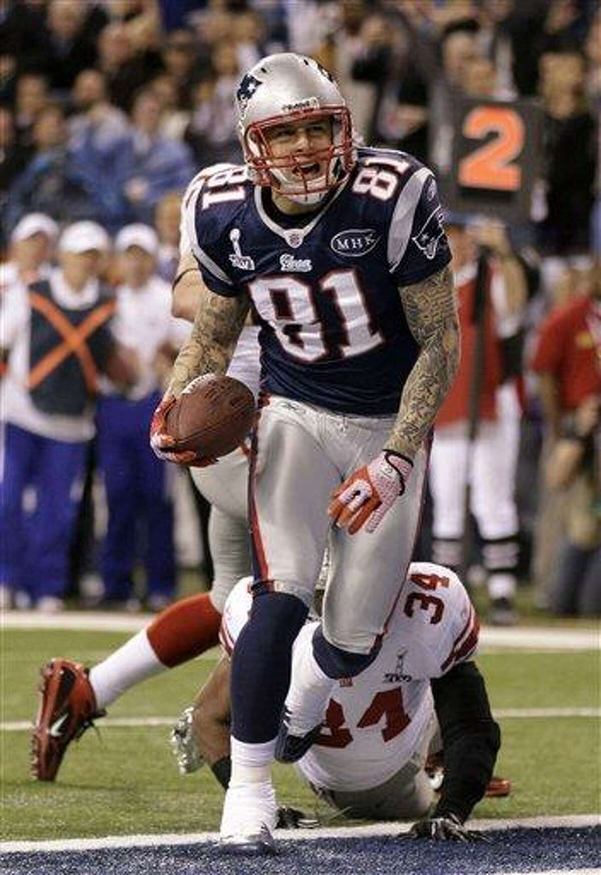 New England Patriots tight end Aaron Hernandez (81) reacts after catching a 12-yard touchdown pass during the second half of the NFL Super Bowl XLVI football game against the New York Giants, Sunday, Feb. 5, 2012, in Indianapolis. (AP Photo/Marcio Jose Sanchez)