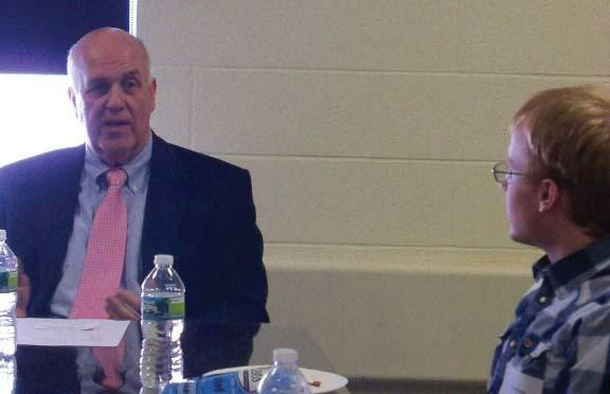Jenny Golfin/Register Citizen. Jeff LaLonde, President and CEO of Torrington Savings Bank, speaks at UConn Torrington's second Career Conversation Luncheon. Above, he answers a question from student Josh Delekta.
