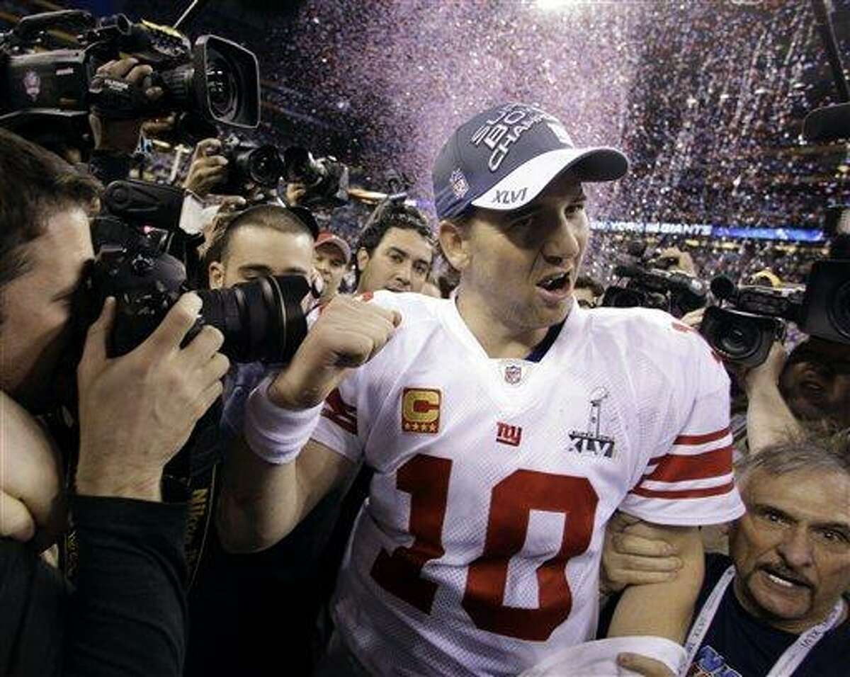 New York Giants quarterback Eli Manning reacts after his team's 21-17 win over the New England Patriots in the NFL Super Bowl XLVI football game, Sunday, Feb. 5, 2012, in Indianapolis. (AP Photo/Eric Gay)