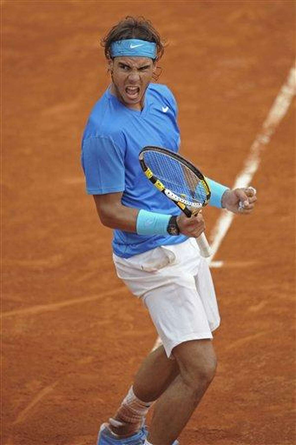 Rafael Nadal of Spain clenches his fist as he takes the second set in his match against Roger Federer of Switzerland in the men's final of the French Open tennis tournament in Roland Garros stadium in Paris, Sunday. (AP Photo/Laurent Baheux)