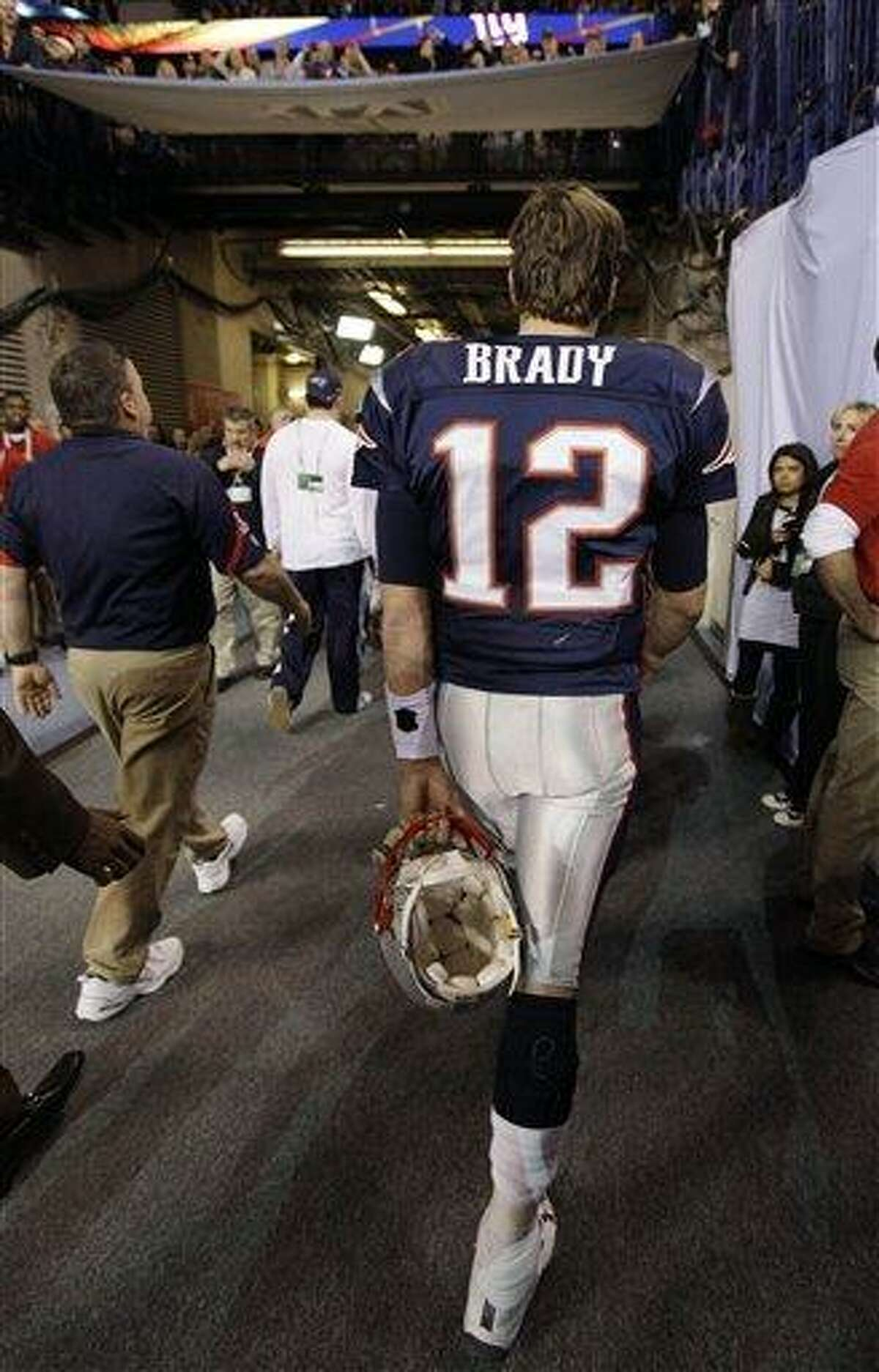 New England Patriots quarterback Tom Brady walks off the field after the Patriots lost to the New York Giants 21-17 in the NFL Super Bowl XLVI football game, Sunday, Feb. 5, 2012, in Indianapolis. (AP Photo/Paul Sancya)
