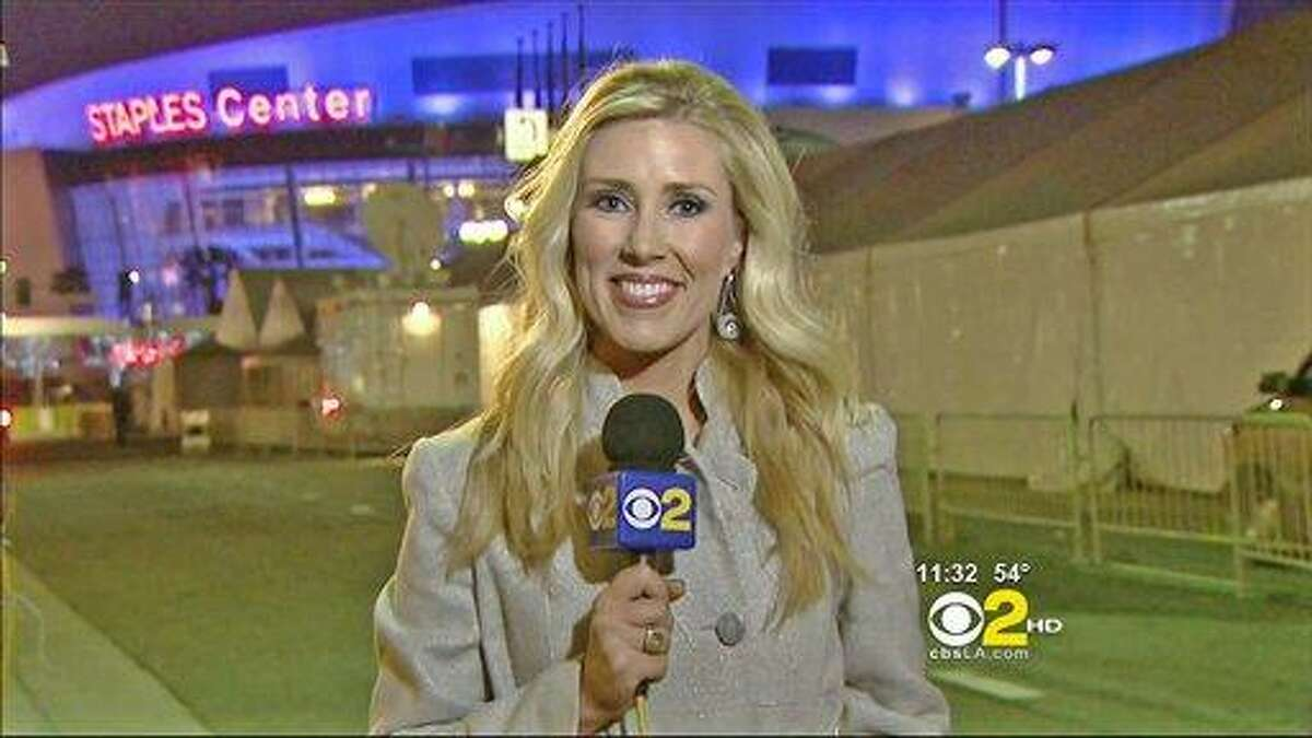In this Sunday, Feb .13, 2011 undated handout file photo provided by KCBS in Los Angeles, veteran TV journalist Serene Branson reports on the Grammy awards show outside the Staples Center in Los Angeles. Branson's speech became incoherent during the stand-up, which fueled Internet speculation that she suffered an on-air stroke. Doctors said Thursday that she suffered a migraine, the symptoms of which can mimic a stroke.