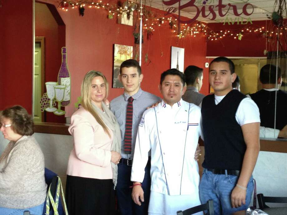 Submitted Photos The Avila family (Diana, Miles, Chef Hector and Cortland) stand in their family-owned Le Bistro Avila, a new European-style restuaurant, on 1241 East Main St.
