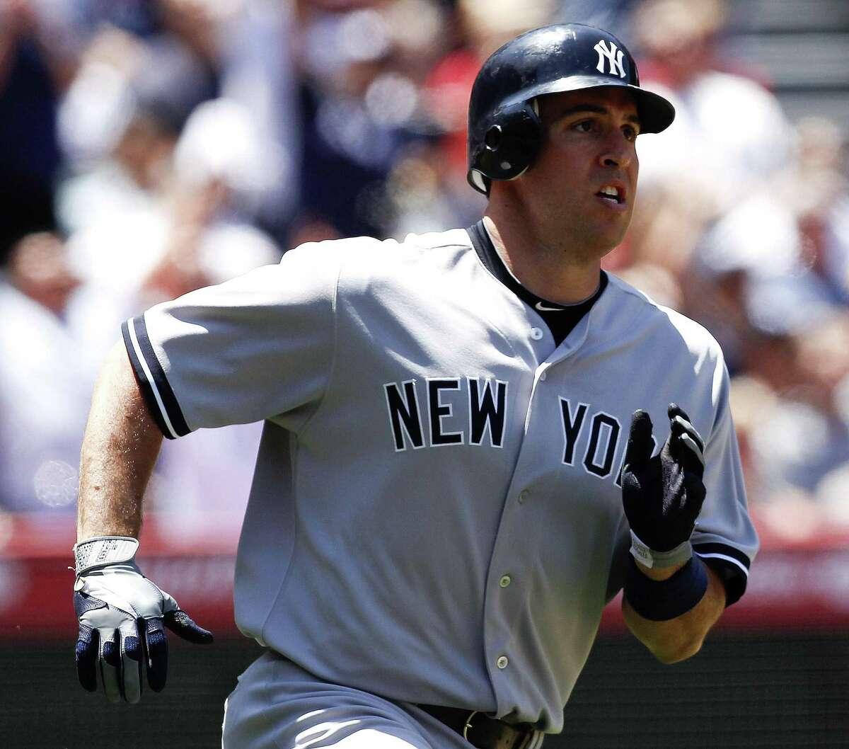 New York Yankees' Mark Teixeira, watches his two-run home run against the Los Angeles Angels during the fifth inning of a baseball game in Anaheim, Calif., Sunday, June 5, 2011. (AP Photo/Chris Carlson)