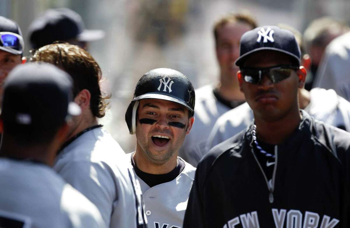 New York Yankees' Nick Swisher celebrates his home run in the dugout during the eighth inning of a baseball game against the Los Angeles Angels in Anaheim, Calif., Sunday, June 5, 2011. (AP Photo/Chris Carlson)