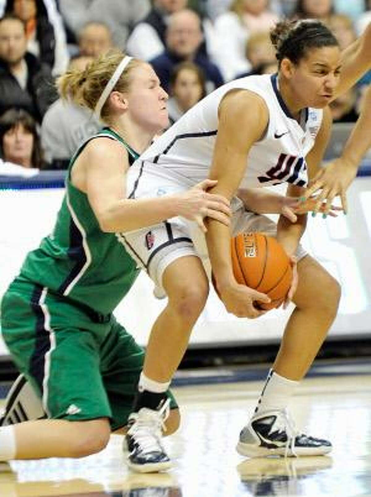 AP Connecticut's Bria Hartley, right is guarded by Notre Dame's Natalie Novosel during the second half of Saturday's game in Storrs. The Huskies won 78-57.