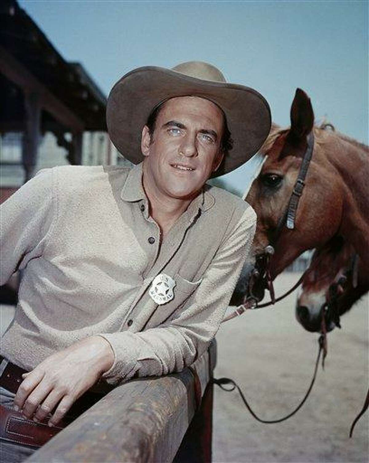 In this undated publicity image released by CBS, Actor James Arness is shown as Marshal Matt Dillon in