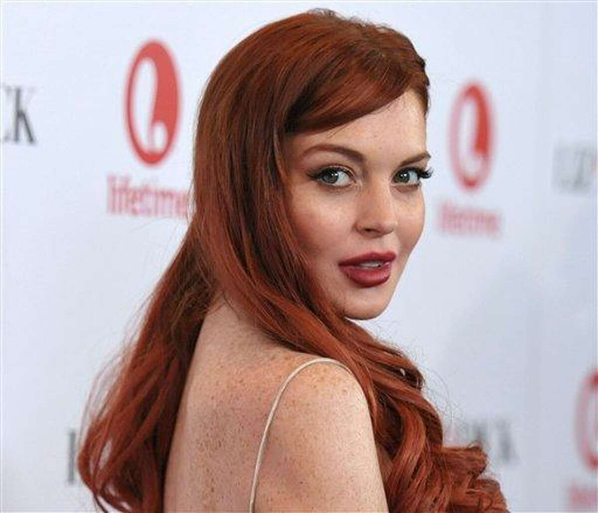 Lindsay Lohan attends a dinner celebrating the premiere of