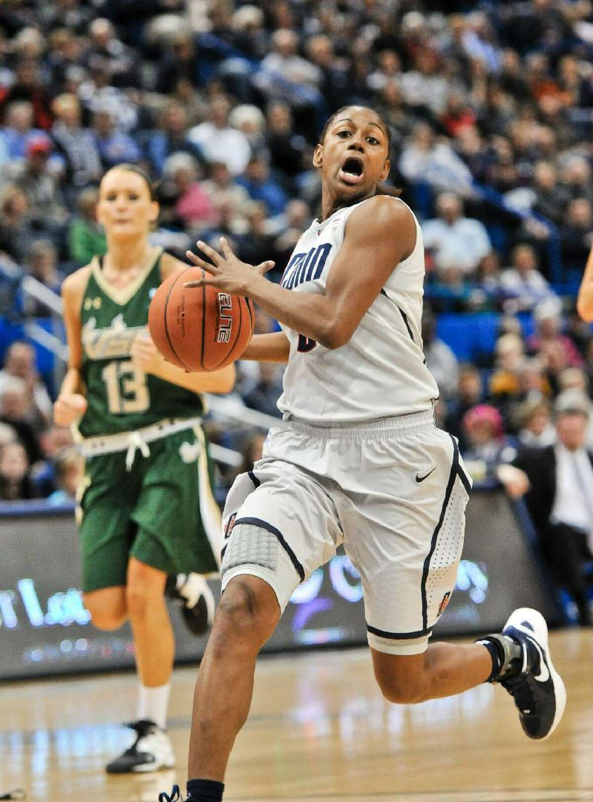 ASSOCIATED PRESS Connecticut's Tiffany Hayes drives to the basket during a Jan. 28 game against South Florida at the XL Center in Hartford. The Huskies face Rutgers tonight at 7.