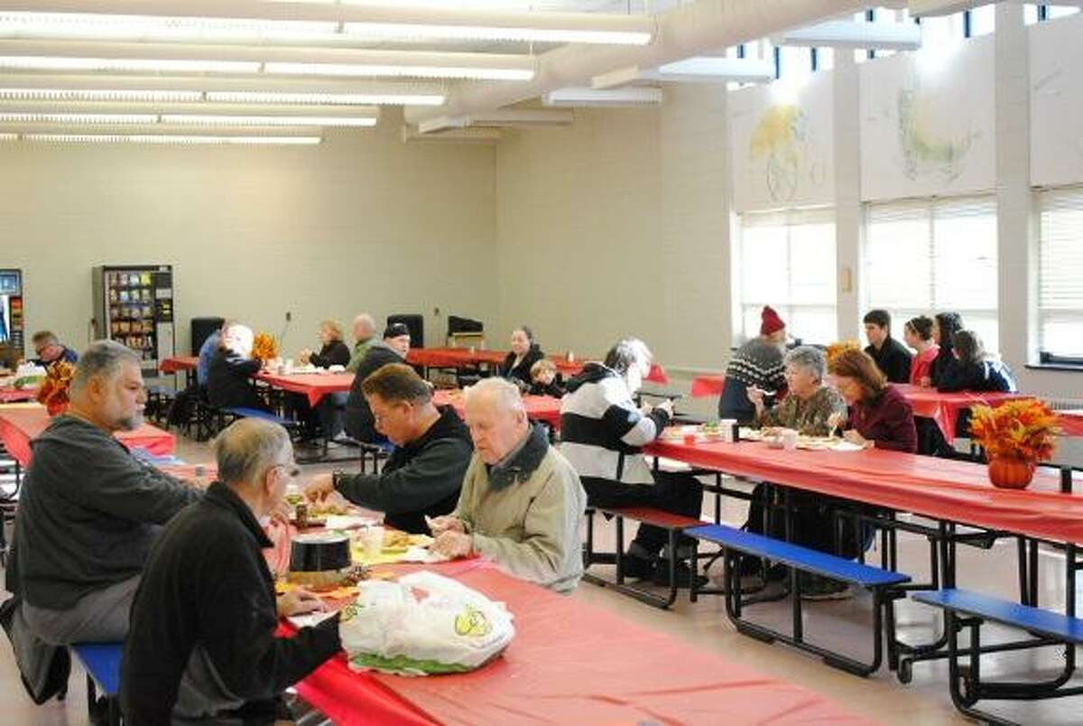 MIKE AGOGLIATI/ Register Citizen Many residents enjoyed a beautiful day, and a meal at Oliver Wolcott Technical High School Thanksgiving Day. Meals were available at the school, and more than 300 were delivered throughout Litchfield County.