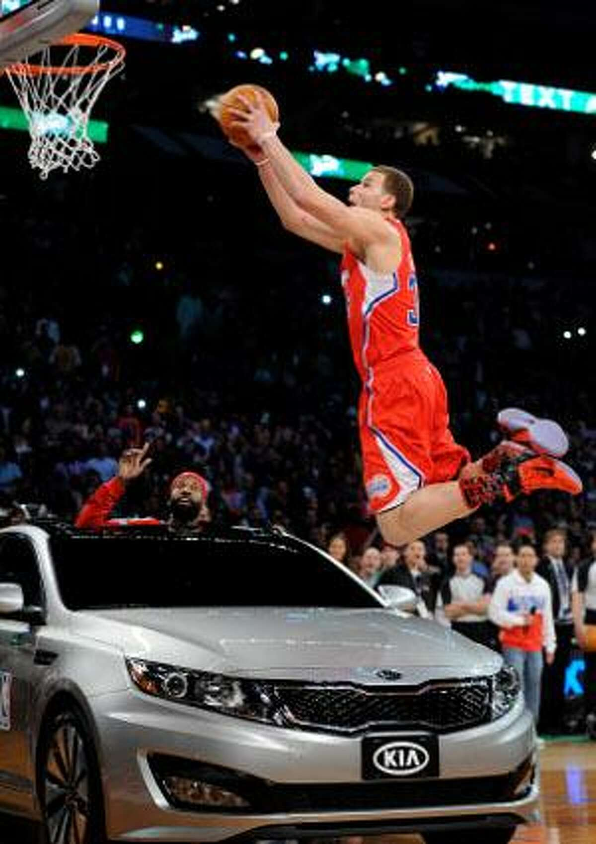 Los Angeles Clippers' Blake Griffin dunks over a car as Baron Davis looks on from inside the car during the Slam Dunk Contest at the NBA All-Star weekend Saturday in Los Angeles. (AP Photo/Mark J. Terrill)